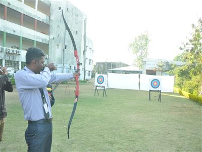 Devendra Sir playing Bow and Arrow